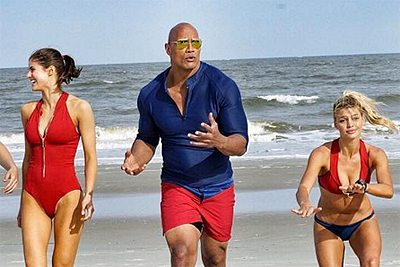 Baywatch Cast Photo: A Rock on a Beach with Some Babes