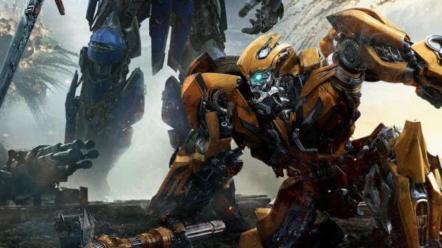 it s optimus vs bumblebee in a new transformers poster howldb. Black Bedroom Furniture Sets. Home Design Ideas