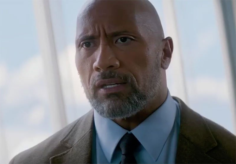Dwayne Johnson is Fired Up in Skyscraper Super Bowl Spot