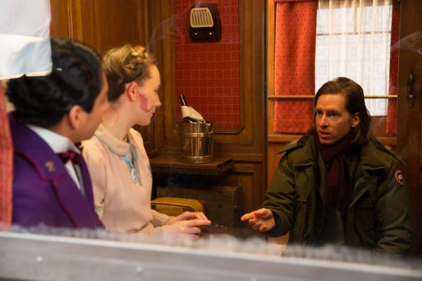 Tony Revolori, Saoirse Ronan and Wes Anderson on the set of THE GRAND BUDAPEST HOTEL.